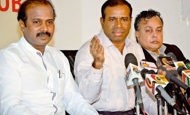 T. Paul Raja, convener, Federation of Beach Mineral Producers' Associations, addressing the media in Chennai on Monday. He is seen here flanked by federation members Thangaraj (left) and Srinivasan. — DC